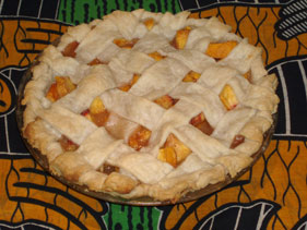 Eat-a-Peach Pie. The cloth is from Ghana and the design is giant hands.